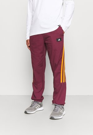 FUTURE ICONS - Tracksuit bottoms - victory crimson