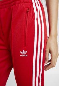 adidas Originals - Tracksuit bottoms - scarlet - 4