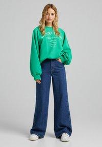 Bershka - Flared Jeans - dark blue - 1
