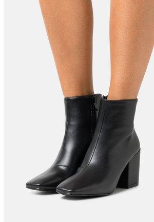 HOLLIS - Ankle boot - black