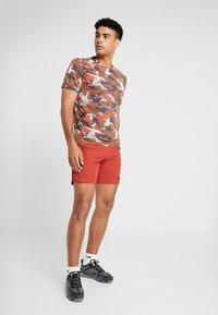 Nike Performance - FLEX REP SHORT - Sports shorts - dune red - 1
