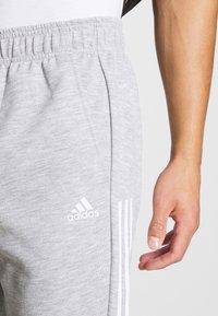 adidas Performance - MUST HAVES AEROREADY SPORTS REGULAR PANTS - Tracksuit bottoms - mottled dark grey - 5