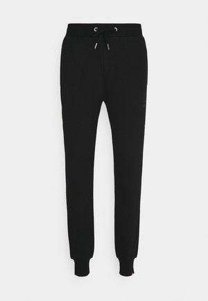 GARNA - Tracksuit bottoms - black