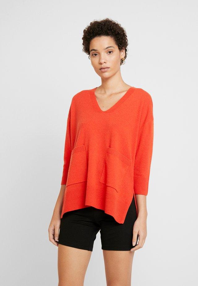 Strikkegenser - flash orange