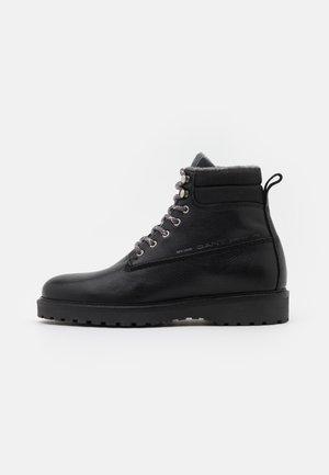 RODEN - Šněrovací kotníkové boty - black