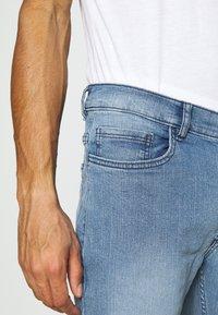 Burton Menswear London - SLIM JEAN - Slim fit jeans - blue - 4