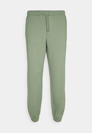 FLEASER TROUSERS  - Teplákové kalhoty - teal