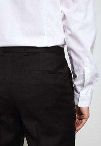 HUGO - HARTLEY - Suit trousers - black - 6