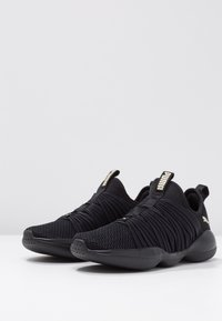 Puma - FLOURISH - Obuwie treningowe - black/metallic gold - 2