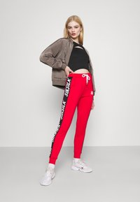 SIKSILK - CHASER TRACK PANT - Tracksuit bottoms - red - 1