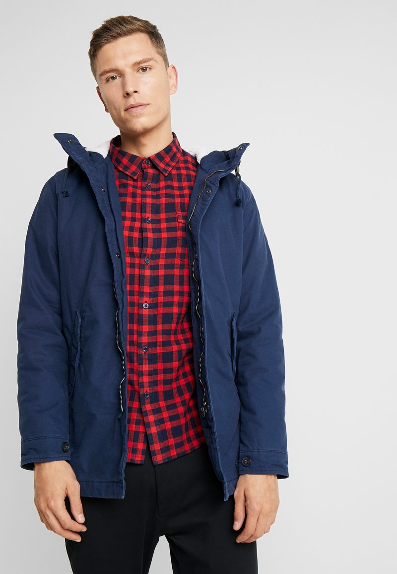 Produkt - PKTAKM PARKA TEDDY JACKET - Parka - dress blues