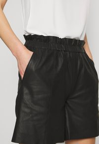 Culture - ALINA - Leather trousers - black - 4