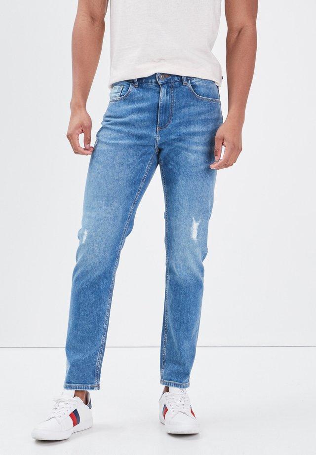 UMWELTFREUNDLICHE - Jeans a sigaretta - denim used