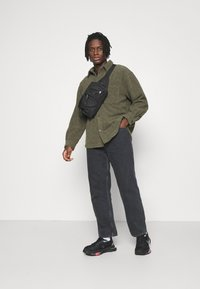 Weekday - GALAXY TROUSERS - Jeans baggy - washed black - 1
