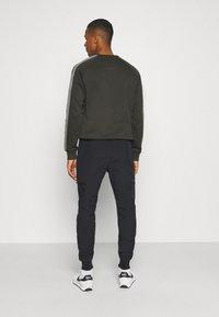 Ellesse - CABOTONE - Pantalones deportivos - black - 2
