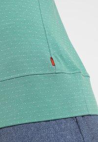 Vaude - WOMENS TUENNO PULLOVER - Long sleeved top - nickel green - 7