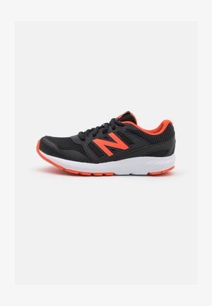 570 UNISEX - Chaussures de running neutres - black/orange