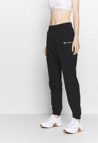 Champion - ELASTIC CUFF PANTS - Pantalones deportivos - black - 0