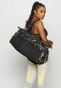 Nike Performance - RADIATE CLUB 2.0 - Sports bag - black/white - 1