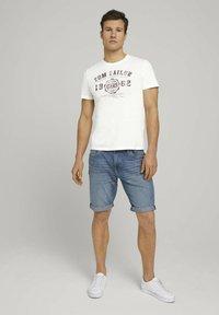 TOM TAILOR - Denim shorts - mid stone wash denim - 1