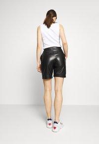 STUDIO ID - CAROLINE SHORTS - Leather trousers - black - 2