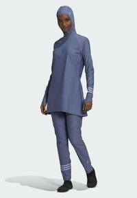 adidas Performance - ADI PBSW TOP SWIM SPORTS WATERSPORTS PRIMEBLUE NYLON RASH GUARD - Long sleeved top - purple - 1