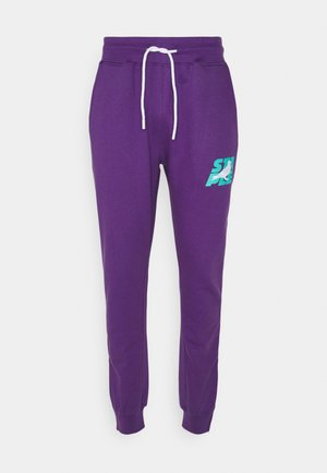 STACKED LOGO - Tracksuit bottoms - purple