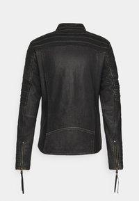 Tigha - CADAN - Leather jacket - black stone wash - 6