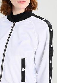 Urban Classics - LADIES BUTTON UP TRACK JACKET - Bomber Jacket - white/black/white - 4