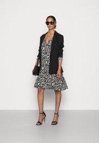 Marc O'Polo - DRESS A-SHAPE GATHERINGS V-NECK LONG SLEEVE - Day dress - black - 1
