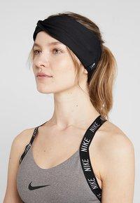 Nike Performance - TWIST KNOT HEADBAND - Ear warmers - black/white - 1
