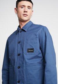 Calvin Klein - WORKWEAR JACKET - Lehká bunda - blue - 4