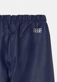 LEGO Wear - POWAI UNISEX - Rain trousers - dark navy - 2
