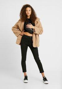 Topshop Petite - COATED CLEAN JAMIE - Jeans Skinny Fit - black - 1