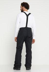 Brunotti - FOOTSTRAP MEN SNOWPANTS - Snow pants - black - 2