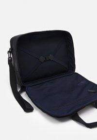 Tommy Hilfiger - HOUR BAG UNISEX - Across body bag - black - 3