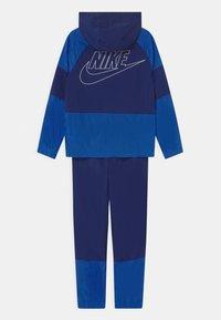 Nike Sportswear - SET UNISEX - Chaqueta de entrenamiento - blue void/game royal/white - 1