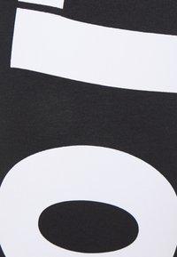 Nike Sportswear - Leggings - black/(white) - 4