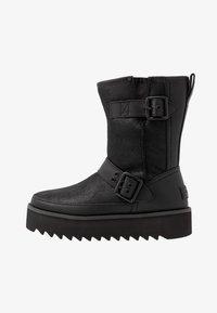 UGG - CLASSIC REBEL BIKER SHORT - Platform boots - black - 1