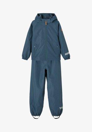 Spodnie przeciwdeszczowe - midnight navy