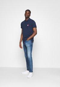 Tommy Jeans - SCANTON SLIM - Slim fit jeans - light-blue denim - 1