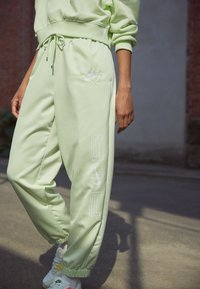 Nike Sportswear - Tracksuit bottoms - lime ice/white - 7