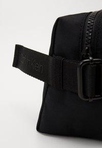 Calvin Klein - NASTRO LOGO WASHBAG - Wash bag - black - 5
