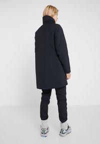 Houdini - ADD-IN JACKET - Short coat - true black - 2