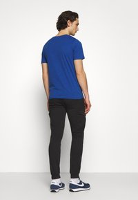 Jack & Jones - JJIMARCO CUFFED - Cargobyxor - black - 2