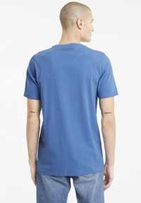 Puma - CLASSICS EMBRO TEE - Print T-shirt - star sapphire - 2