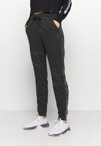 ONLY Play - ONPONAY SLIM PANTS - Træningsbukser - black/silver - 0