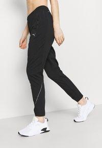 Puma - RUN TAPERED PANT - Pantalones deportivos - black - 3