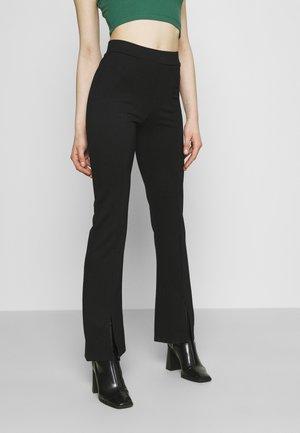 JDYPRETTY FLARE SLIT PANT  - Trousers - black