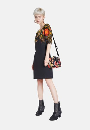 DESIGNED BY M. CHRISTIAN LACROIX - Across body bag - black